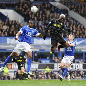 Arouna Kone, centre, has signed a three-year deal at Goodison Park