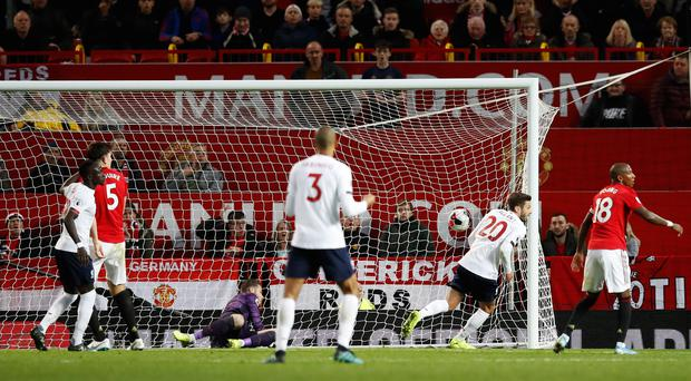 Adam Lallana salvaged a point for Liverpool at Old Trafford (Martin Rickett/PA)