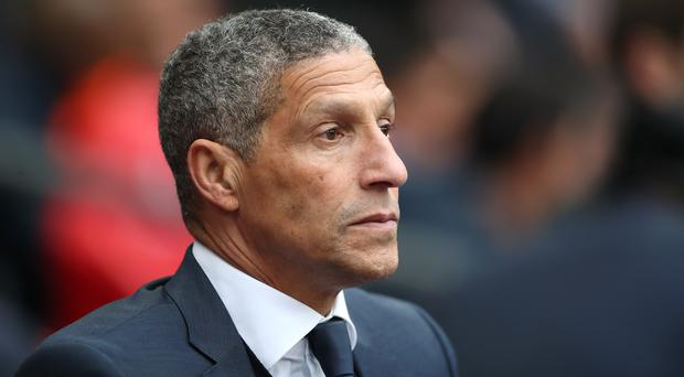 Brighton manager Chris Hughton knows his side still have work to do to secure their top-flight status (Nick Potts/PA)