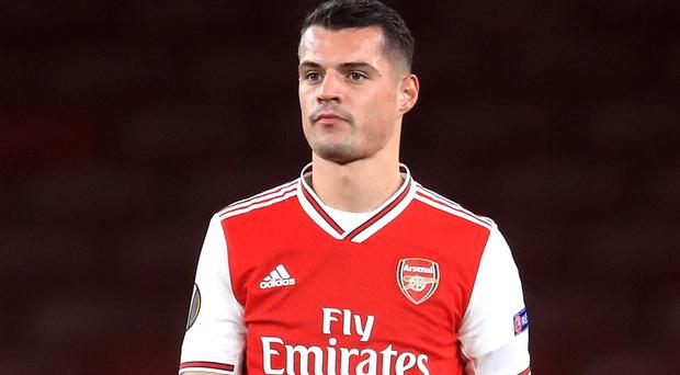Arsenal's Granit Xhaka, pictured, is expected to stay at the club by new manager Mikel Arteta (Adam Davy/PA)