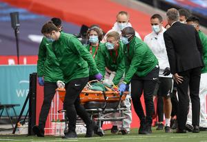 Eric Bailly was taken away on a stretcher on Sunday (Andy Rain/NMC Pool)