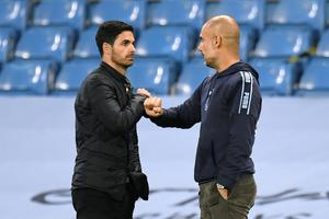 Guardiola (right) drew a distinction between Arsenal on and off the pitch in his praise of the Gunners (Peter Powell/NMC Pool)