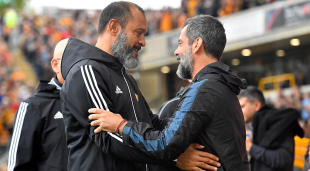 Nuno Espirito Santo, left, and Quique Sanchez Flores were left with contrasting emotions (Dave Howarth/PA)