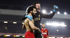 Liverpool's Mohamed Salah, left, celebrates his side's second goal of the game with Liverpool goalkeeper Alisson Becker (Martin Rickett/PA)