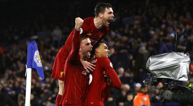 Trent Alexander-Arnold (right) celebrates scoring Liverpool's fourth in their win over Leicester (Tim Good/PA).