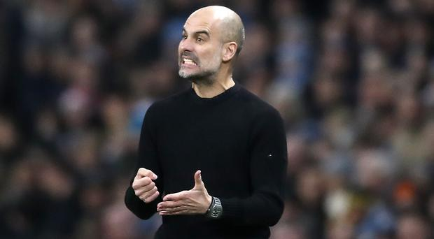 Pep Guardiola got his 100th Premier League win in charge of Manchester City on Sunday (Martin Rickett/PA)