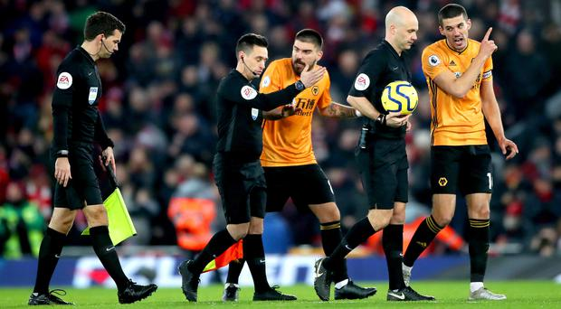 Wolves' Conor Coady speaks to referee Anthony Taylor following a controversial VAR decision (Nick Potts/PA)