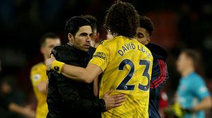 Arsenal's manager Mikel Arteta (left) has said he wants to keep David Luiz (right) at the club. (Mark Kerton/PA)