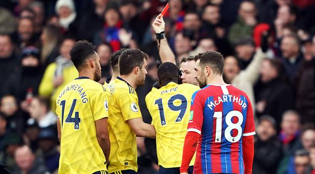 Arsenal captain Pierre-Emerick Aubameyang (left) was sent off after VAR had a look at his tackle on Crystal Palace midfielder Max Meyer (Tess Derry/PA)