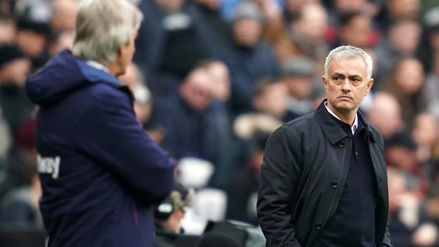 Tottenham manager Jose Mourinho (right) and West Ham boss Manuel Pellegrini on the touchline during the Premier League match at the London Stadium.