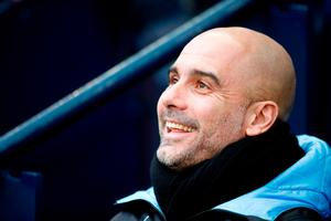 All smiles: Pep Guardiola was delighted to see City overturn their Euro ban