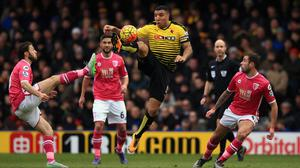 Troy Deeney, centre, guards possession for Watford
