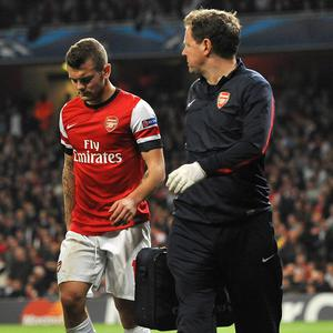 Jack Wilshere, left, was substituted with an ankle complaint in Arsenal's defeat to Borussia Dortmund on Tuesday