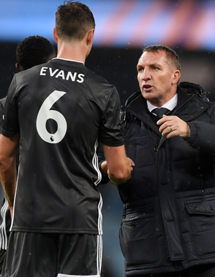 United: Leicester City boss Brendan Rodgers with Jonny Evans