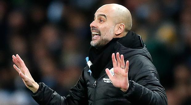 Pep Guardiola is not happy Manchester City have to play twice in less than 48 hours over Christmas (Martin Rickett/PA)