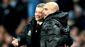 Pep Guardiola (right) is preparing to face Ole Gunnar Solskjear (left) this weekend (Martin Rickett/PA)