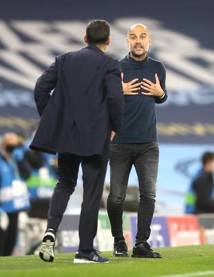 Pep Guardiola (right) exchanges words with Porto boss Sergio Conceicao on Thursday (Martin Rickett/PA)