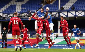 Michael Keane heads Everton level after Sadio Mane's opener for Liverpool at Goodison Park.