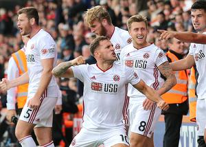Sheffield United captain Billy Sharp, centre, celebrates wildly after stepping off the bench to grab a late equaliser at Bournemouth on the opening weekend. Chris Wilder's newly-promoted Blades enjoyed a season to remember, securing a top-half finish in their first Premier League campaign since 2006-07 (Mark Kerton/PA)