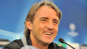 On this day in 2012, Roberto Mancini signed a new long-term deal with Manchester City (MArtin Rickett/PA)