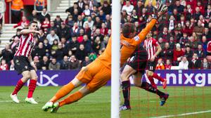 Southampton's Shane Long, left, scores against Burnley