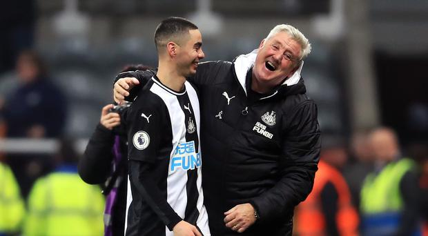 Newcastle head coach Steve Bruce celebrates with match-winner Miguel Almiron (Owen Humphreys/PA)