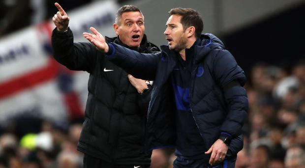 Chelsea manager Frank Lampard, right, gestures during the win over Tottenham (Nick Potts/PA)