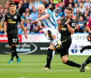 Hot shot: Aaron Mooy hits Huddersfield's eye-catching winner