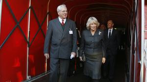 Sir Chips Keswick, pictured with the Duchess of Cornwall, has retired from his role as Arsenal chairman (Kirsty Wigglesworth/PA)
