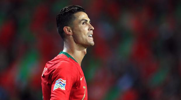 Cristiano Ronaldo said he almost signed with Arsenal instead of Manchester United (Mike Egerton/PA)