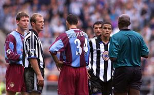 Alan Shearer is about to be sent off by Uriah Rennie for clashing with Colin Calderwood (Owen Humphreys/PA)