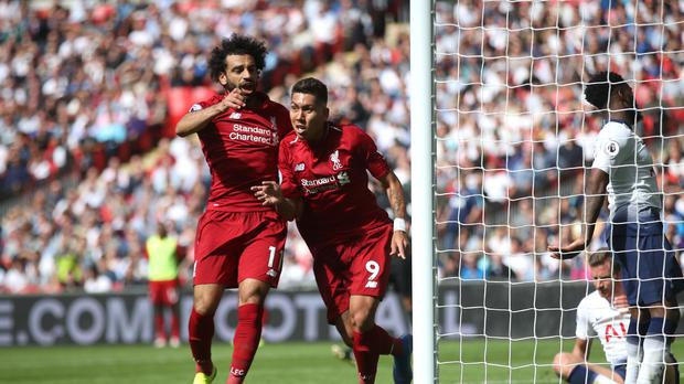 Roberto Firmino, right, celebrates with Mohamed Salah after scoring Liverpool's second goal (Adam Davy/PA)