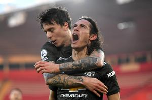 Cavani (right) scored two late goals as United came from behind to beat Southampton in November (Mike Hewitt/PA)