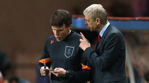 Arsene Wenger, right, believes a line has to be drawn over behaviour towards referees