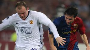 Wayne Rooney and Lionel Messi locked battle in the Champions League (Nick Potts, PA)