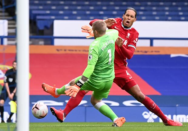 Liverpool's Virgil Van Dijk (right) was clattered by Jordan Pickford (Laurence Griffiths/PA)