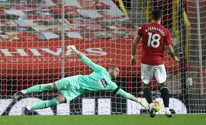 Sam Johnstone saved from Bruno Fernandes' penalty but had moved off his line too soon (Martin Rickett/PA)