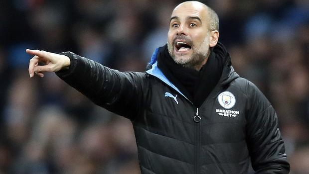 Pep Guardiola is focusing on other targets after falling well behind Liverpool (Martin Rickett/PA)