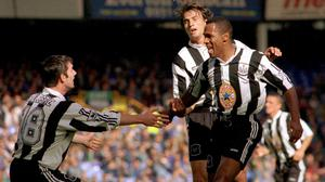 Les Ferdinand, right, scored 29 goals for Newcastle in 1995-96 (Paul Barker/PA)