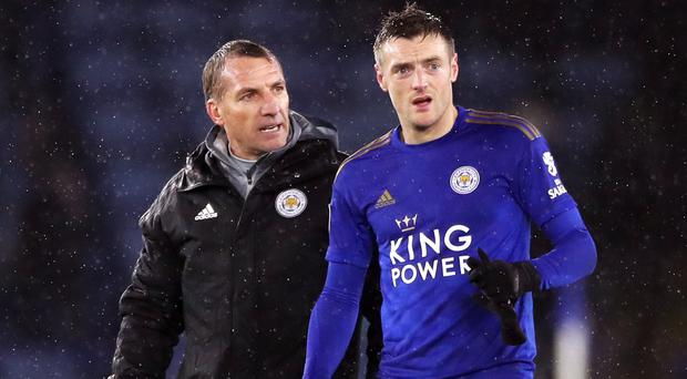 Leicester manager Brendan Rodgers, left, does not believe Jamie Vardy will change his mind over again playing for England (Nick Potts/PA)