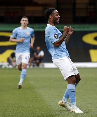 Raheem Sterling, who scored twice, celebrates City's opener at Watford (PA)