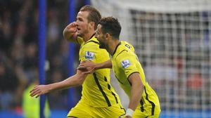 Harry Kane, left, celebrates opening the scoring for Tottenham