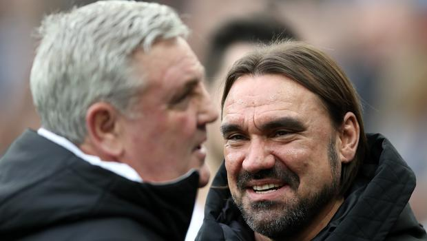 Norwich manager Daniel Farke, right, and Newcastle head coach Steve Bruce emerged with a point apiece a St James' Park (Owen Humphreys/PA)
