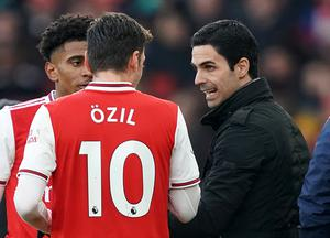 Mikel Arteta was instrumental in Arsenal's players agreeing to a pay cut – but Ozil refused to do it (John Walton/PA)