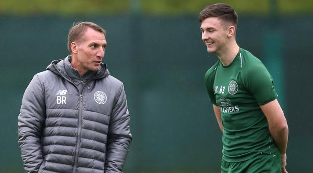 Brendan Rodgers (left) and Kieran Tierney will cross swords for the first time on Saturday since they left Celtic (Jane Barlow/PA )