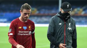 Liverpool, including Jordan Henderson (left) and manager Jurgen Klopp, missed out on three points at Everton (PA)