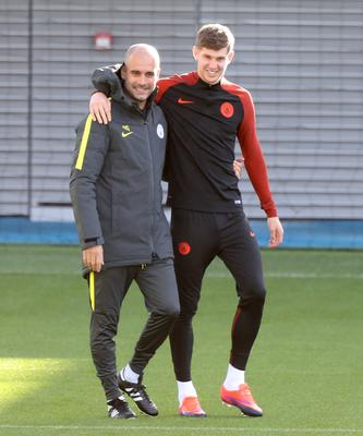 Guardiola, left, continues to rate Stones very highly (Simon Cooper/PA)