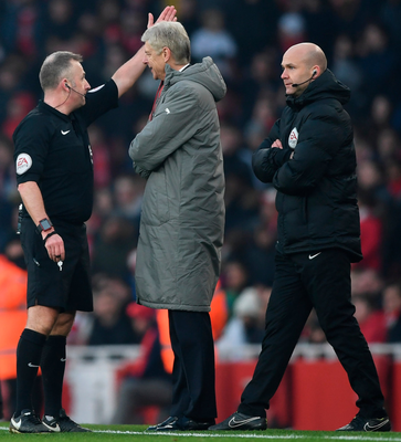 Seeing red: Arsenal boss Arsene Wenger is sent to the stands