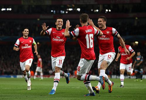 Arsenal's Mesut Ozil (second left) has added a new dimension to Arsenal's midfield