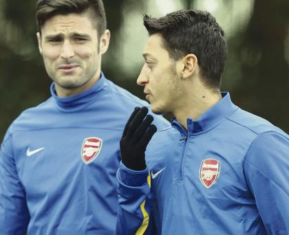 Olivier Giroud (left) started on the bench against Hull